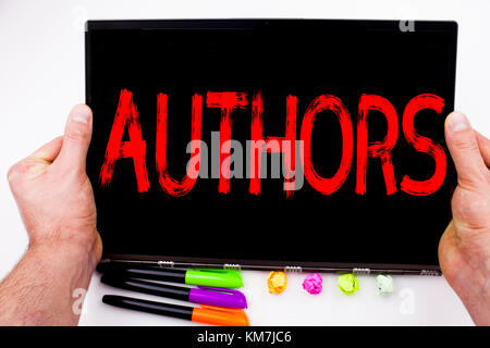 Authors text written on tablet, computer in the office with marker, pen, stationery. Business concept for Word Message - Stock Photo