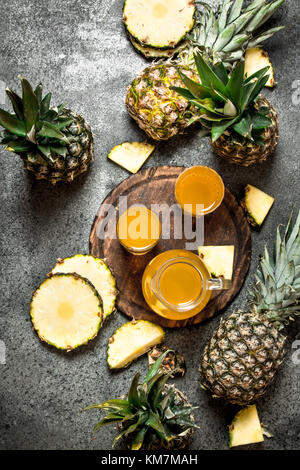 Freshly squeezed pineapple juice. On rustic background. - Stock Photo