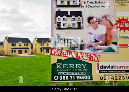 Newly constructed detached family homes in housing estate development in village of Abbeydorn, County Kerry Ireland. - Stock Photo