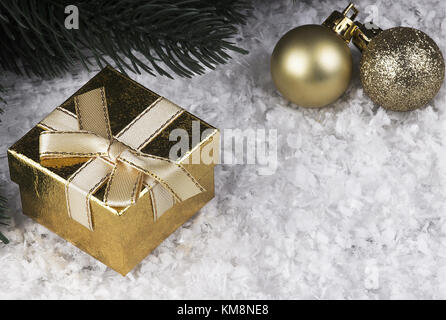 Christmas decoration with snowlakes golden gift box and Christmas balls - Stock Photo