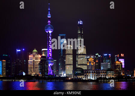 Shanghai, China - November 4, 2017:  Night shot of the magnificent skyline of Shanghai Pudong area including the - Stock Photo