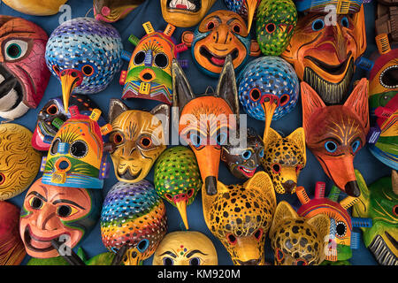 Otavalo, Ecuador - December 2, 2017: closeup of colourful indigenous wood carvings in the Saturday artisan market - Stock Photo