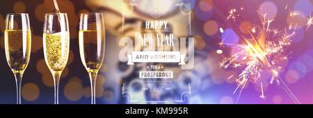 Happy New Year message against illuminated sparkler against defocused background - Stock Photo