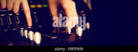 Cropped hands of audio engineer using sound recording equipment at recording studio - Stock Photo