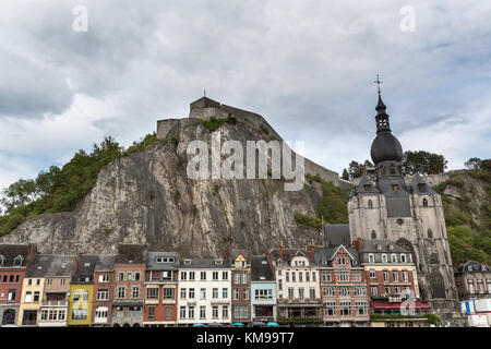 Town of Dinant, Belgium. Picturesque view of Dinant, with the Collegiate Church of Our Lady in the foreground and - Stock Photo