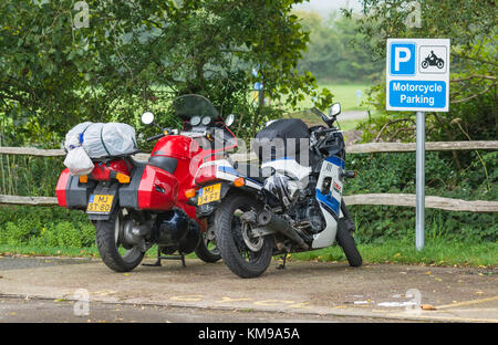 Motorcycle parked in an area of a car park reserved just for motorbikes, in the UK. - Stock Photo