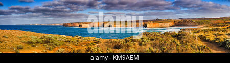 Warm gentle morning sun light around Sherbrook bay and river creek on rugged remote shipwreck coast on Great Ocean - Stock Photo