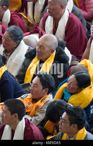 Buddhist disciples listening to His Holiness the 14th Dalai Lama at Namgyal Monastery in McLeod Ganj, India - Stock Photo