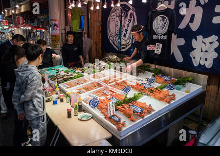 Kanazawa - Japan, June 8, 2017: Fresh seafood and king crabs are sold at the Omicho Market - Stock Photo