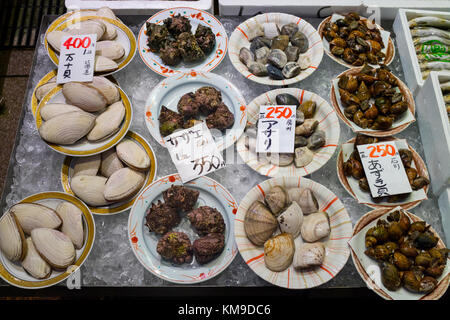 Kanazawa - Japan, June 8, 2017: Dishes with fresh diversity of sea shells on ice and price tags at the Omicho Market - Stock Photo