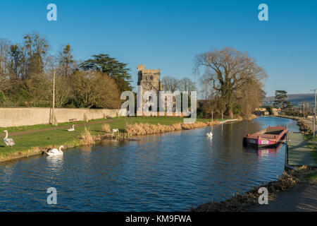 Evening falls over the Church of St. Cyr, Stonehouse and the Stroudwater Canal. Near Stroud Gloucestershire, UK - Stock Photo
