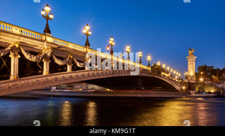 Panoramic view of the Pont Alexandre III bridge illuminated in evening with the Seine River. 8th Arrondissement, - Stock Photo