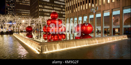 Giant red Christmas ornaments on 6th Avenue with holiday season decorations. Avenue of the Americas, Midtown Manhattan, New York City