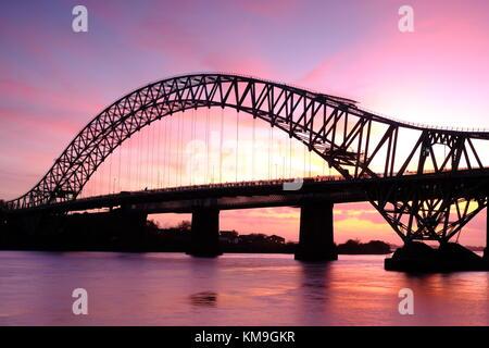 Runcorn Bridge, also known as Runcorn-Widnes Bridge or Silver Jubilee Bridge, over the River Mersey, UK - Stock Photo
