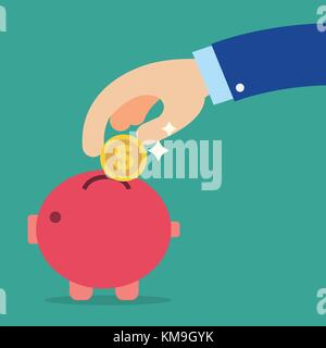 Business hand holding coin into red piggy bank with green background.Saving money concept - Stock Photo