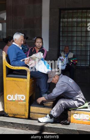 Shoe shine service, Plaza Grande, Quito Ecuador, South America - Stock Photo