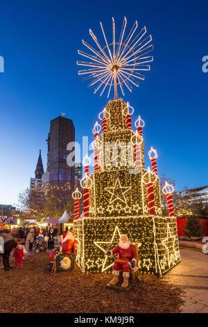 Christmas Market at Kaiser Wilhelm Memorial Church, Breitscheidplatz, Berlin, Germany - Stock Photo