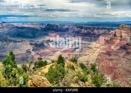 Grand Canyon National Park Arizona landscape view with the Colorado River in the distance. Layered bands of red - Stock Photo