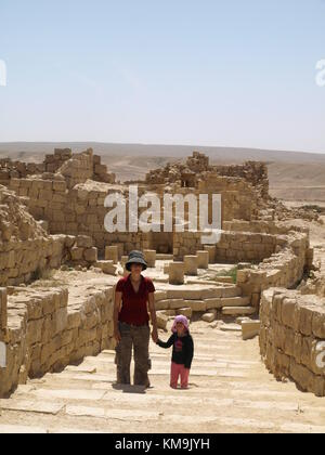 mother and daughter visiting Ancient city remains and walking on an old road or stairway - Stock Photo