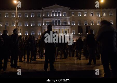 Greeks rally in front of Parliament against ongoing third review of bailout program and future economic measures. - Stock Photo