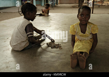Two kids playing a game with stones in Kawaza village, Eastern Province, Zambia - Stock Photo
