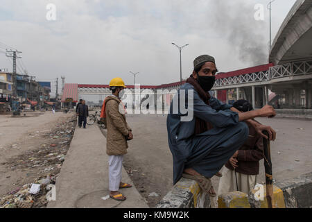 Protesters set up new road-blocks near the Faizabad interchange as riots spread throughout the country using anything - Stock Photo