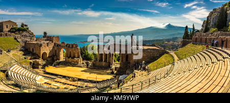 A panoramic view of the Ancient Theatre in Taormina, Sicily. Its position is unique as it overlooks both the Mediterranean sea and Etna Volcano