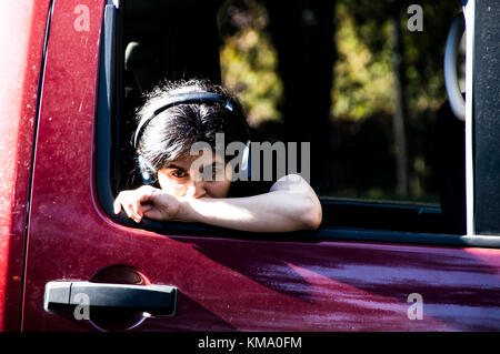 Teen out of a car window - Stock Photo