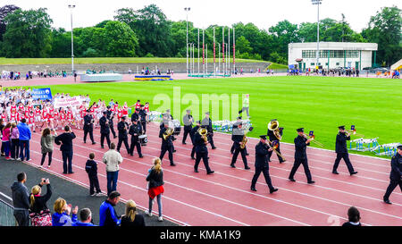 Garda band, Marching band leading the parade for community games athletics, Adults & Children walking around Morton - Stock Photo