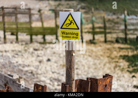 Sign: 'Warning - sudden drop', Cuckmere Haven, near Seaford, East Sussex, UK - Stock Photo