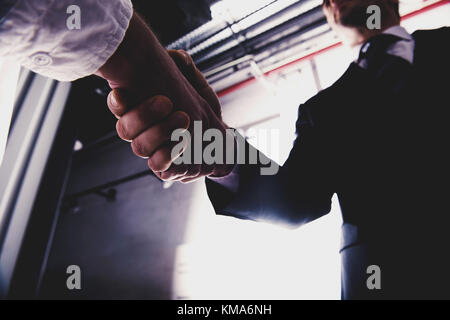 Handshaking business person in office. concept of teamwork and partnership - Stock Photo