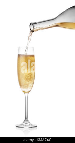 Pouring champagne from a bottle in glass - Stock Photo