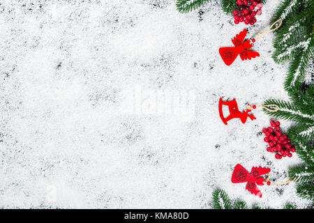 Christmas background with snowflakes, white snow, toys, candy, Christmas tree branches and New Year decor. Winter - Stock Photo