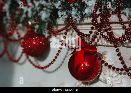 Christmas garlands with red Christmas tree balls - Stock Photo