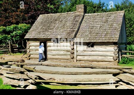 Ulster American Folk Park, County Tyrone, Ireland. Reconstruction of Pennsylvania log cabin lived in by 19th C. - Stock Photo