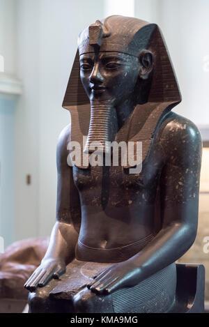 London. England. British Museum. Statue of Egyptian Pharaoh Amenhotep III wearing a Nemes. - Stock Photo