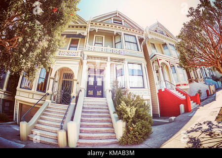 Vintage stylized fisheye lens picture of the Painted Ladies houses seen from the street, San Francisco, USA. - Stock Photo