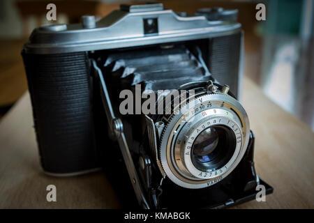Vintage horizontal folding medium format 6x6 camera Agfa Isolette 1 with Agnar lens - Stock Photo