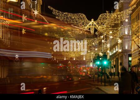 LONDON, UK - DECEMBER 4th, 2017: Christmas lights on Regents Street St James. Beautiful Christmas decorations attract - Stock Photo