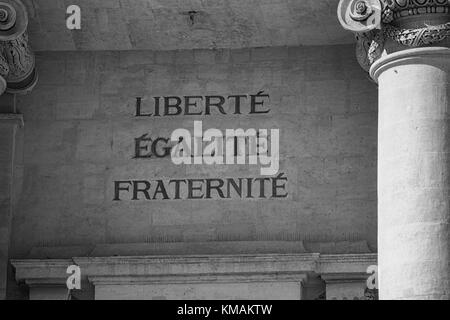 LIBERTE EGALITE FRATERNITE engraved in stone on the facade of an old building in France - Stock Photo