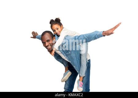 father piggybacking daughter - Stock Photo
