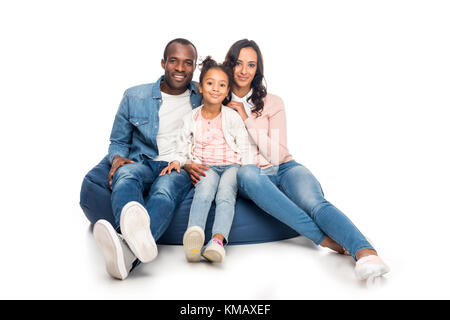 african american family on bean bag chair - Stock Photo