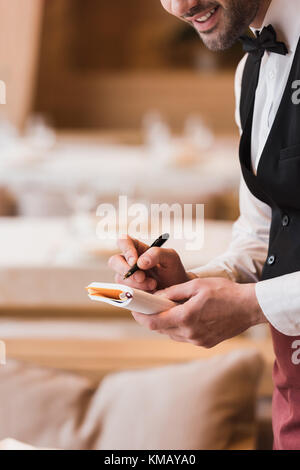 waiter writing down the order - Stock Photo