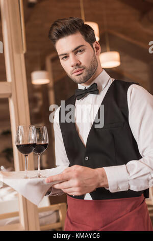 waiter holding tray with wineglasses  - Stock Photo
