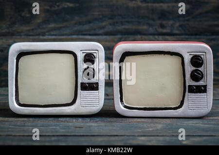 Retro television Trinkets on Blue Background - Stock Photo