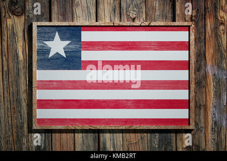 3d rendering of Liberia flag on a wooden frame over a planks wall - Stock Photo