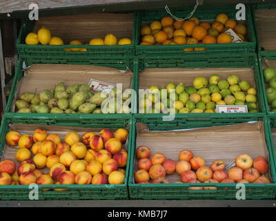 fruits in boxes on the market stand - Stock Photo