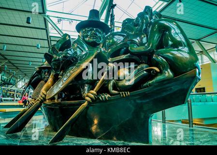 Cast bronze sculpture, The Spirit of Haida Gwaii, the Jade Canoe, by artist Bill Reid,  Vancouver Airport, YVR, - Stock Photo