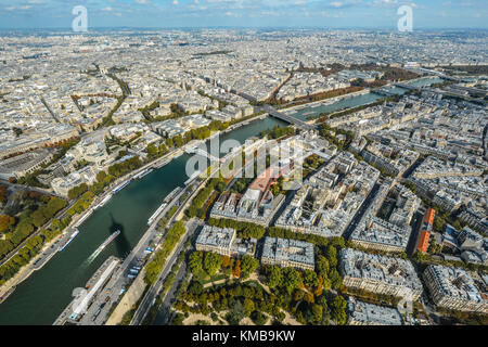 View of the city of Paris on a sunny day in early autumn from the 3rd, top level of the Eiffel Tower - Stock Photo