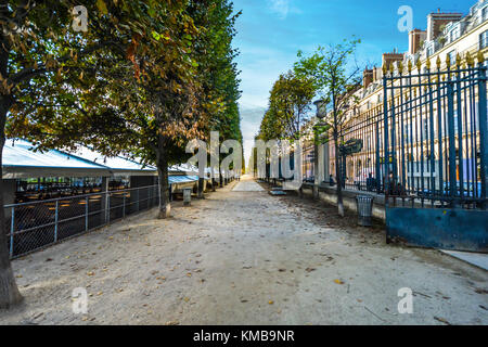 The gated entrance to the Tuileries Garden, or Jardin des Tuileries on a sunny day in early autumn in Paris France - Stock Photo